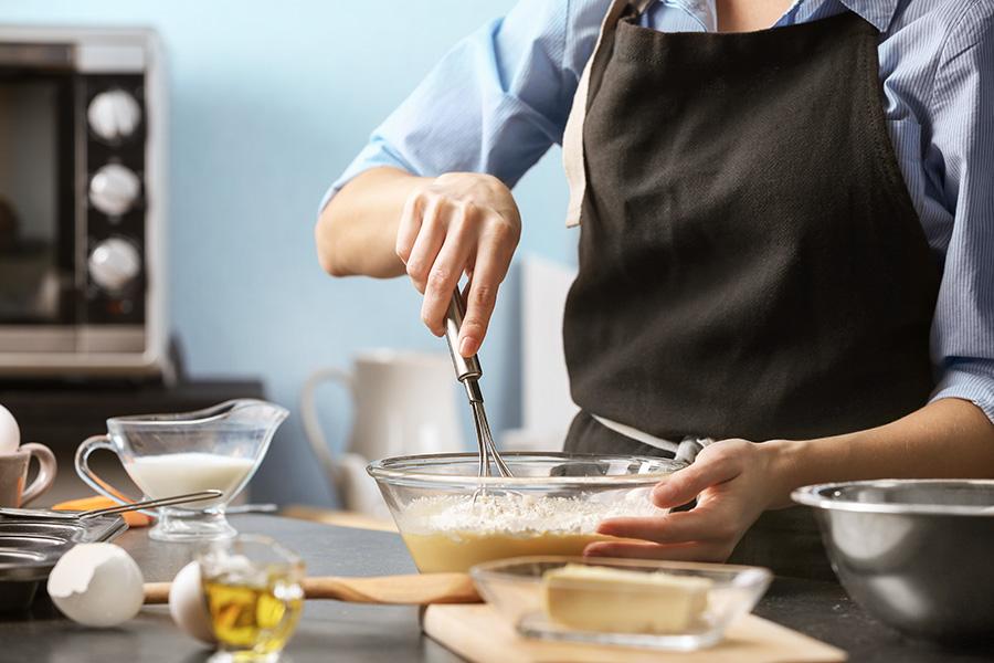Cook mixes ingredients.
