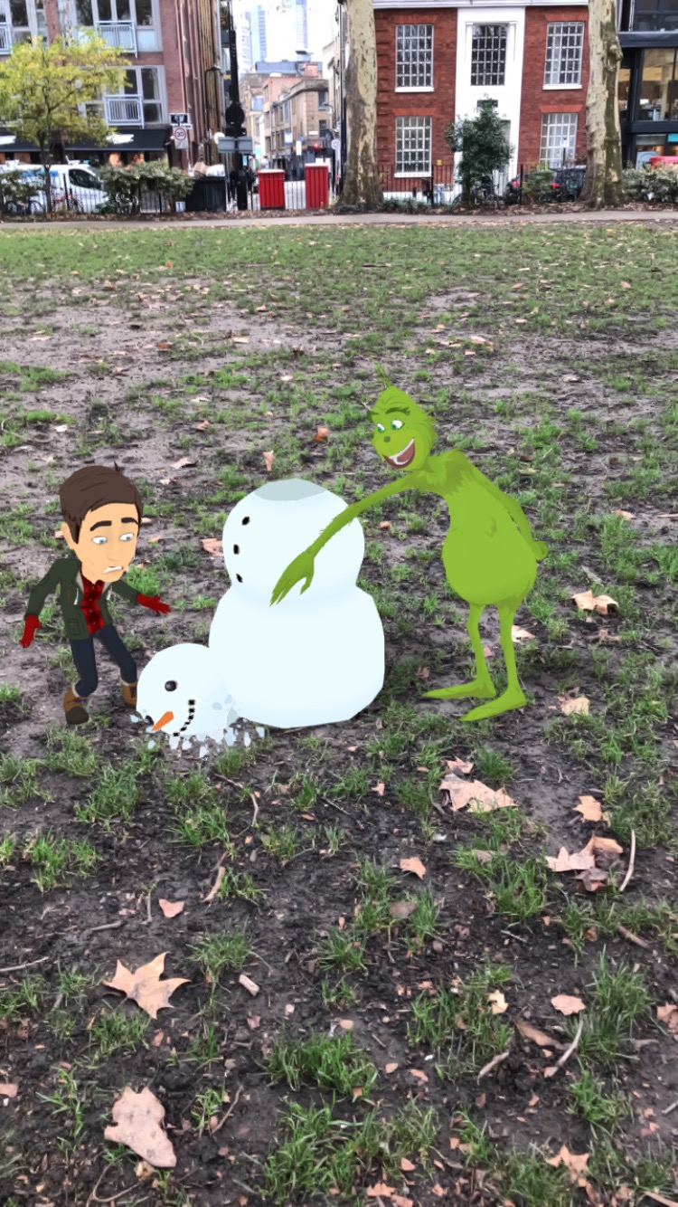 Cartoon version of the Grinch laughing as he pushes the head off a cartoon snowman which splats on the floor while the brown-haired white male author's Bitmoji watches with a terrified expression on his face
